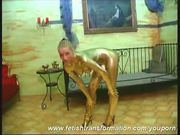 Crazy girl complete painted in gold (clip)