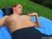 Redhead with glasses spreads her legs outside