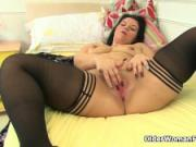 Curvy milf Louise Bassett is fingering her mature pussy