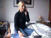 Busty blonde masturbates on the phone