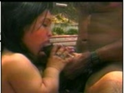 Midget gal sucks on big black sausage