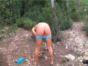 Olga in the woods...shows us her asshole