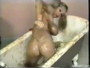 Big titted hottie takes a bath of food - Pt. 3/4