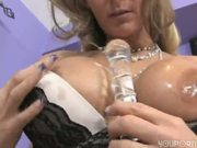 Horny blonde gapes her holes with toys