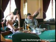 Naked duo posing flexible in casino