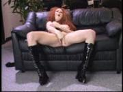 Sultry redhead strips for you
