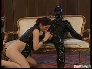 Man clad in leather suit satisfies sexy lady
