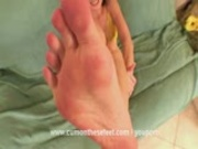 Sexy babe giving a wet footjob to cumshot