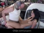 Old mechanic fucks hot brunette client on the car