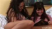 Girls playing with a purple dildo