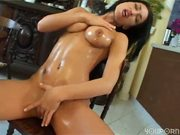 Hottie lubes up with oil then lubes up with cum