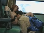 Hot Redhead Poses on a Train
