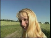 Cute farm girl gets naked in the field