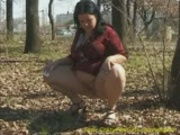 Busty whore pisses outdoor