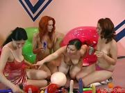 Four chicks in a toy party