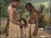 Two African tribesman show the white woman what they got