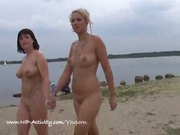 Two sexy girls naked in public