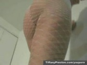 Hot babe Tiffany stripping in fishnet suit