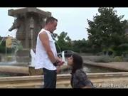 Anthea is fucked by two guys right by a fountain