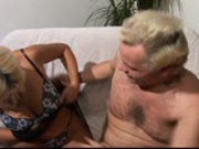He massages her cunt while masturbating himself