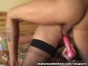 This big mature loves her hard dildo.....