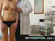 A spy cam footage of a nude girlie during physical check-up