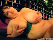 Heavy woman models different color dildos