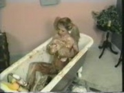 Big titted hottie takes a bath of food - Pt. 2/4