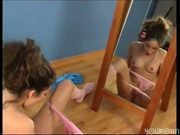 Wanna be dancer watches herself play in mirror