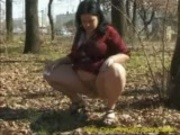 chubby babe peeing in forest