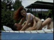 Pool boy lounges around with fiery redhead
