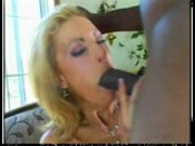 Blonde bimbo sucks big black cock