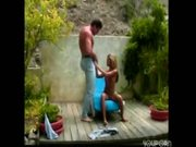 petite girl and huge guy play outside