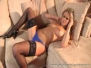 Busty blonde Candice wearing sheer holdups