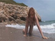 Eva struts around the beach