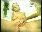 two girls use dildo to play with each other