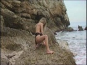 Lydie naked on the rocks