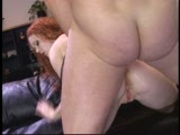 Sluty redhead takes it in the ass