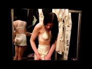 Putting On A Pair Of Seamed Stockings-
