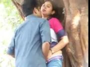 Mature lady and young guy having fun in park MMS
