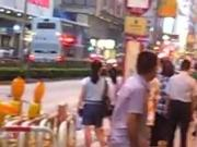 Asian woman stripped naked on street