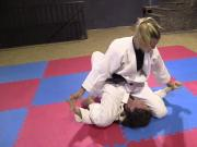 Girls wrestling in kimonos pindown match