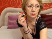 Smoking granny with red lips and nails