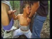 Pretty girl with 2 men in forest