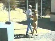 Big Boobed Blonde Strung Up and Whipped Outdoors