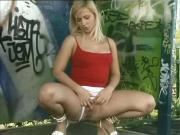 Blond slag pissing outside 4