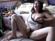 Busty and hairy amateur girl rubs her pussy