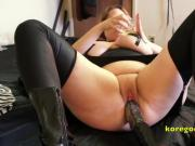 Gothic Wife with huge breasts fills her cunt