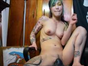 Inked and pierced teen takes a load from her dildo
