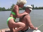 Blonde Old Granny has Fun on the Riverbank